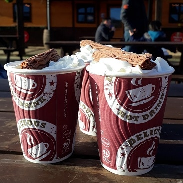 Picture of three cups of hot chocolate complete with cream and chocolate flakes on top at The North Pole in Cambridge