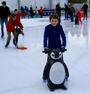 My children skating along with the help of penguin skate aids at The North Pole in Cambridge
