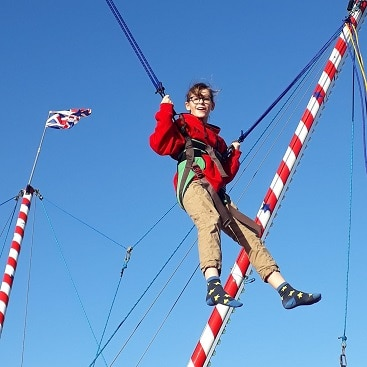 Picture of my daughter doing bungee trampolining at The North Pole in Cambridge