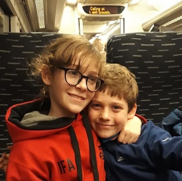 Picture of my two children on the train home after visiting The North Pole in Cambridge