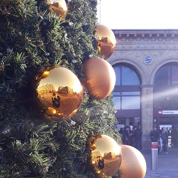 Picture of gold baubles on the Christmas tree at Cambridge station for our day out by train to the North Pole