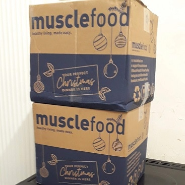 Picture of 2 big Muscle Food boxes containing the Muscle Food EasyCook 3 Courses Recipe Box