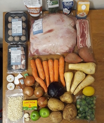 Picture of the contents of the Muscle Food EasyCook 3 course recipe box, with all the food laid out on our kitchen table