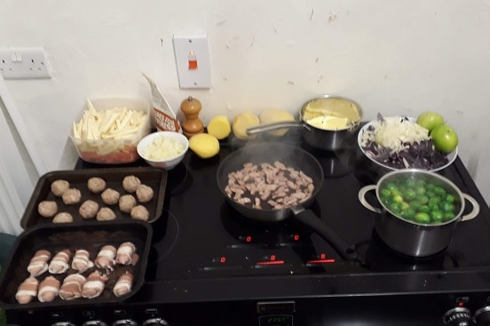 Picture of the top of our cooker spread with ingredients from the MuscleFood Easy Cook Three Course Christmas Recipe box