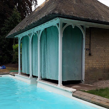 Picture of a swimming pool and changing room for my post onwhich Vanguard LifeStrategy fund is right for you