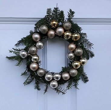 Picture of a home made Christmas wreath with yew and baubles