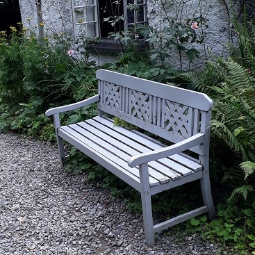 Picture of a bench in a garden for my post on which Vanguard LifeStrategy fund is right for you