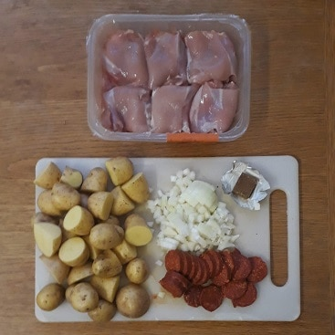 Picture of the ingredients for chicken, chorizo and potatoes for my post on cutting food costs in January