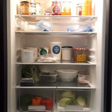 Picture of the inside of my fridge for a post about cutting food costs in January