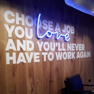 Picture of a slogan on the B Works Manchester walls: Choose a job you love and you'll never have to work again