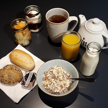 Picture of my breakfast at Point A Shoreditch, with fruit, yogurt, tea, juice, muesli and a couple of rolls