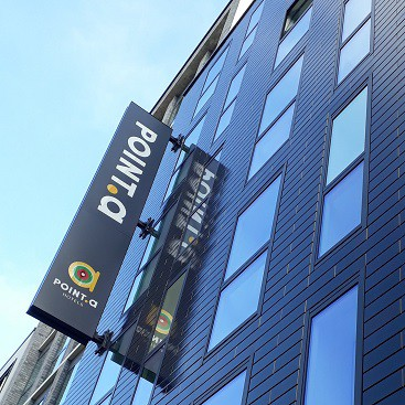 Exterior of the Point A Hotel in Shoreditch, with hotel sign