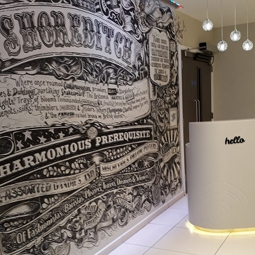Picture of the lobby at Point A Shoreditch with mural and check in stand