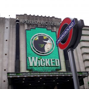 Picture of the front of the theatre for Wicked, with a London Underground sign