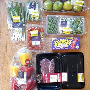 Picture of yellow stickered bargains for my post with an update on cutting food costs in January