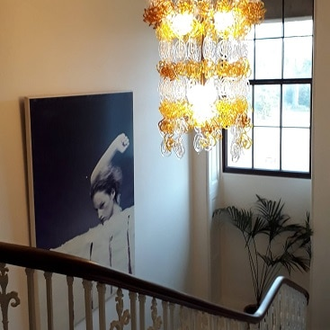 Picture of a staircase with stunning chandelier and modern art at The Ickworth Hotel
