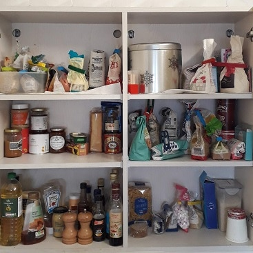 Picture of the inside of our food cupboard for my post on how to cut food costs in January
