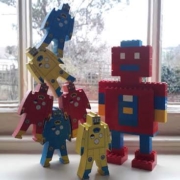 Picture of wooden stacking robot toys and a lego robot for my post on what are robot advisers?