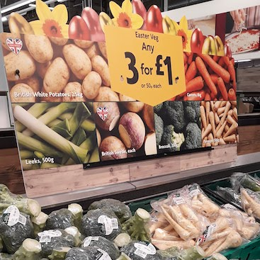 Picture of display of 3 for £1 Easter veg in Morrisons