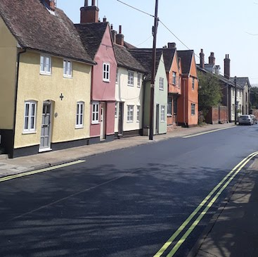 Picture of the cottages with newly resurfaced road