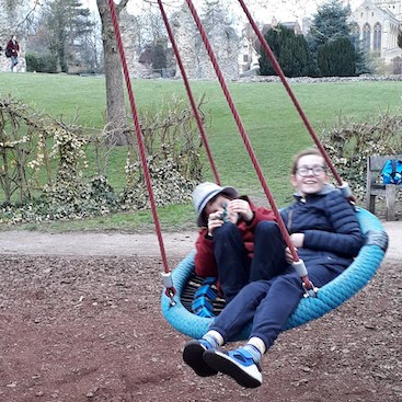 Picture of my two children on a swing in the Abbey Gardens in Bury St Edmunds