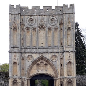 Picture of the stone Abbey Gatehouse in Bury St Edmunds for my post about our fun family trip by train