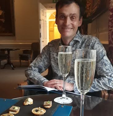 Picture of my husband enjoying a drink and canapés as part of a set menu