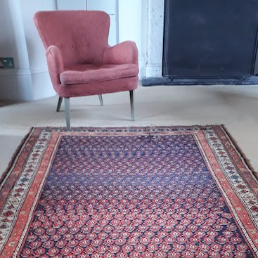 Picture of pink rug and pink chair in our sitting room