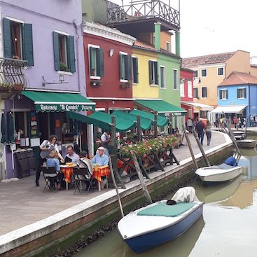 Picture of colour houses and restaurant by canal on the island of Burano