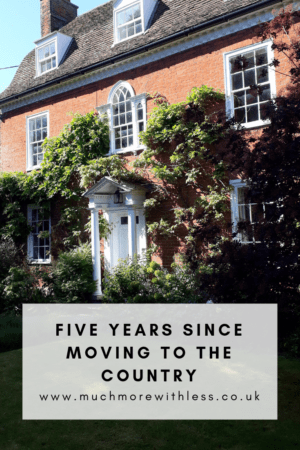 Pinterest sized image of the front of our house for my post on five years since moving to the country