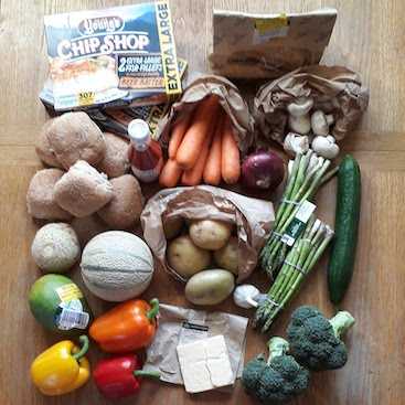 Picture of a fruit, veg, cheese & box of fish fillets as I try to do plastic-free food shopping