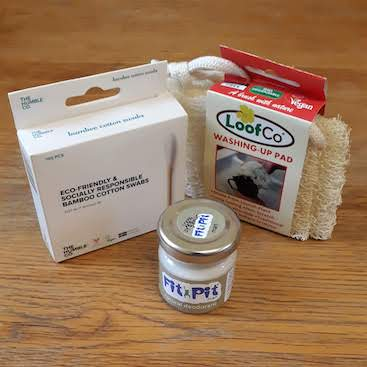 Picture of the bamboo swabs, deodorant in glass jar and loofah washing up sponge from the REco store