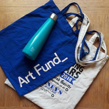 Picture of two reusable cloth bags and my metal water bottle