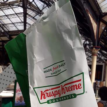 Picture of a Krispy Kreme paper bag, for my free doughnut from the app