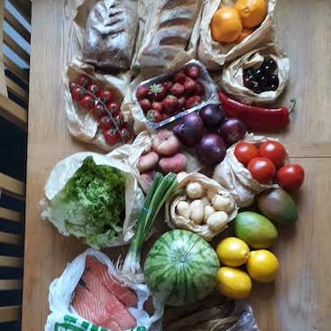 Picture of fruit, veg, bread and fish from the market