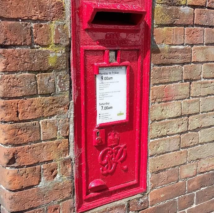 Picture of the red post box in our garden wall