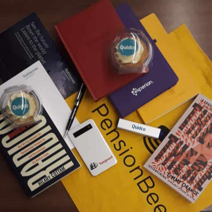 Picture of my freebies from the SHOMO awards, including notebooks, cupcakes, novels, a pen and power banks, for my post on five frugal things for September