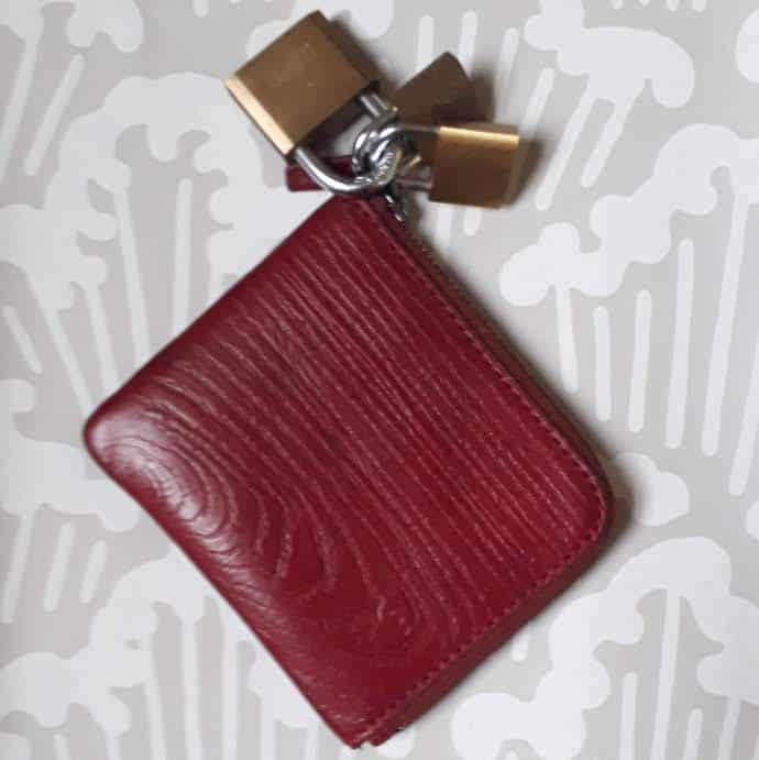 Picture of a red wallet with three padlocks for my post on how to stop impulse spending