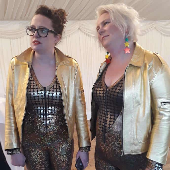Picture of Ellie and Helen, the Scummy Mummies, modelling gold catsuits and jackets