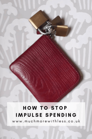 Pinterest size image of purse with padlocks for my post on how to stop impulse spending