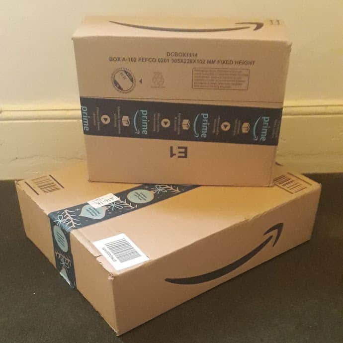 Picture of two Amazon boxes, with stuff bought with my Amazon cashback voucher