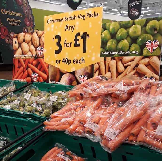 Picture of Morrisons display of carrots and Brussel sprouts for my post on the cheapest Christmas veg