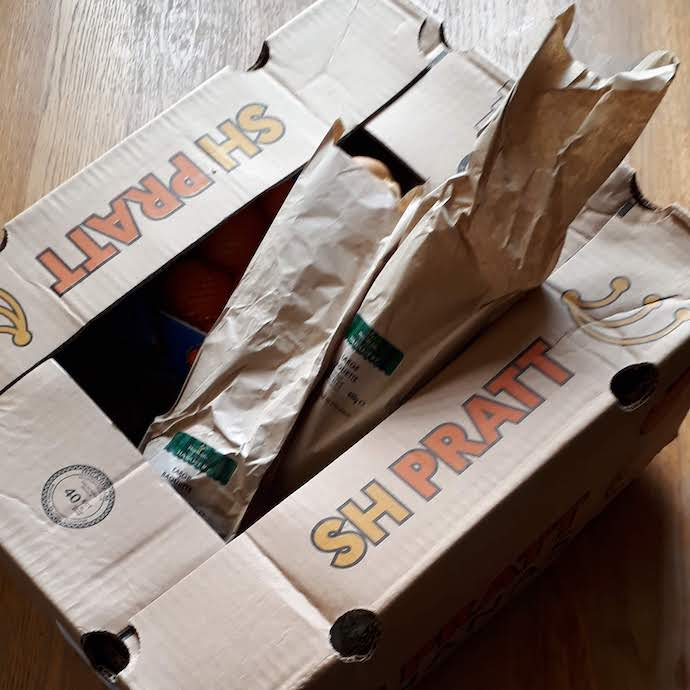 Picture of a brown box with baguette bags from Morrisons via Too Good To Go