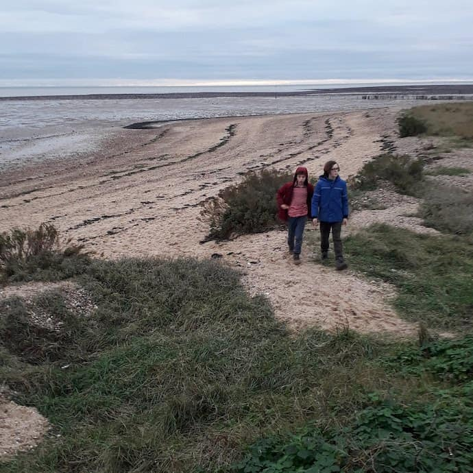 Picture of my two children walking on the beach on Mersea Island, as one of my five frugal things this week