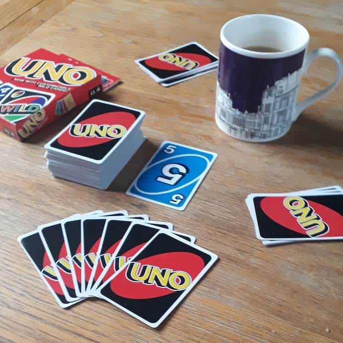 Picture of a game of Uno and mug of tea