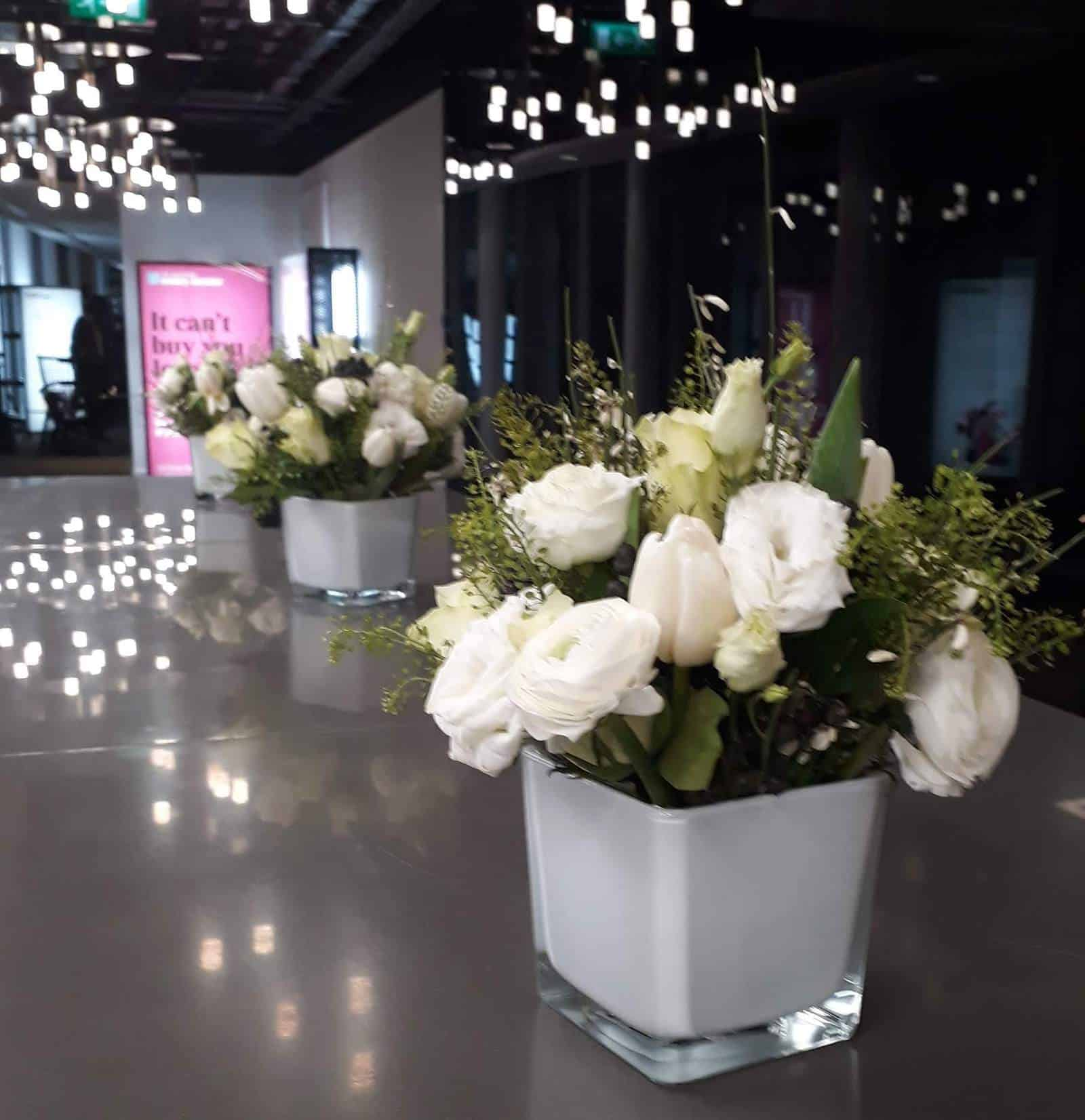 Picture of vases of white flowers at the Times Money Mentor launch party