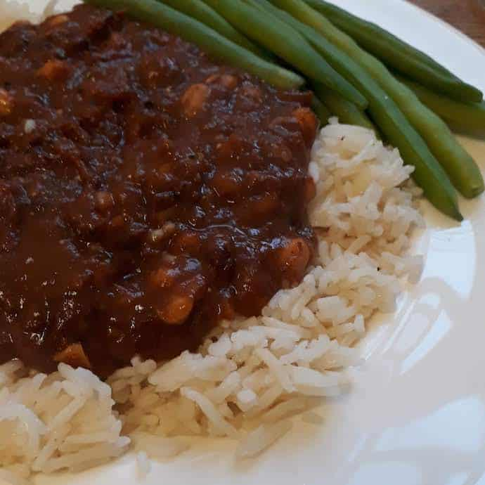 Picture of rice, chilli and green beans on a plate