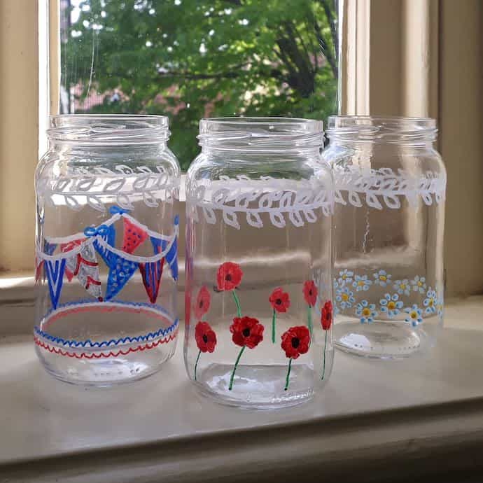 Picture of jam jars decorated with bunting, poppy and forget-me-not pictures, for VE Day