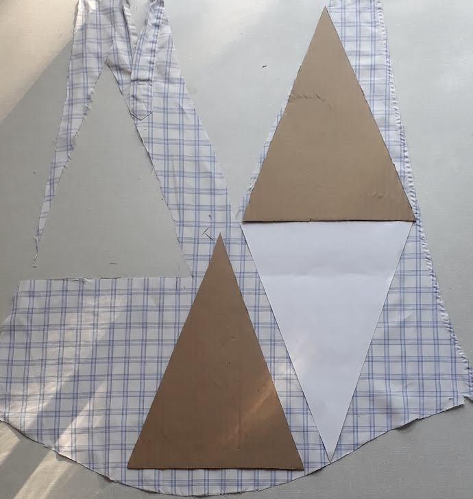 Picture of cardboard bunting pattern pieces on the sleeve from a man's shirt