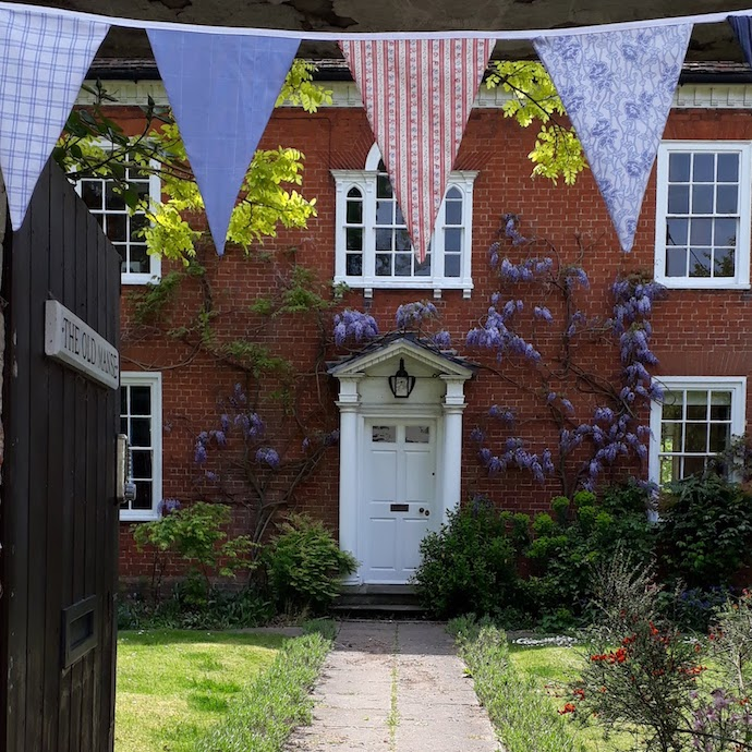 Picture of the front of our house with bunting